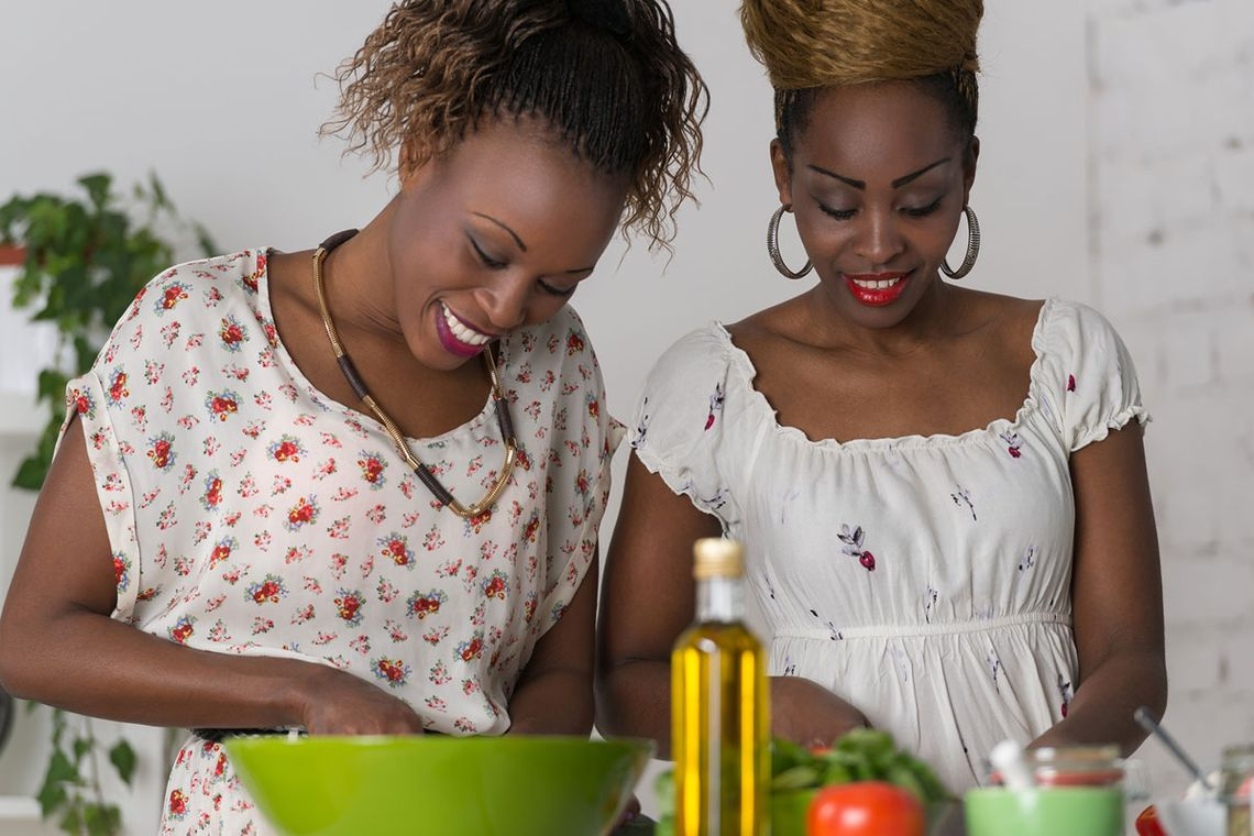 Two African woman cooking in a kitchen